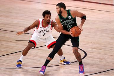 Kyle Lowry #7 of the Toronto Raptors defends Jayson Tatum #0 of the Boston Celtics