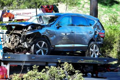 A tow truck holds the vehicle Tiger Woods drove in a crash that injured him