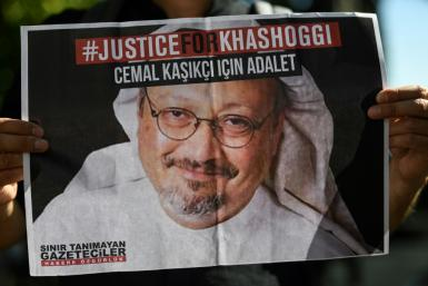 Friends of Saudi journalist Jamal Khashoggi hold posters bearing his picture in front of Saudi Arabia's Istanbul consulate where he was murdered, on the second anniversary of his killing in October 2020