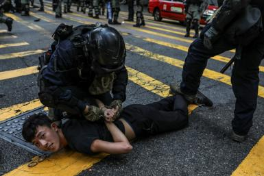 Beijing is battling to stamp out dissent in semi-autonomous Hong Kong after swathes of the city hit the streets in 2019 with huge and sometimes violent democracy protests