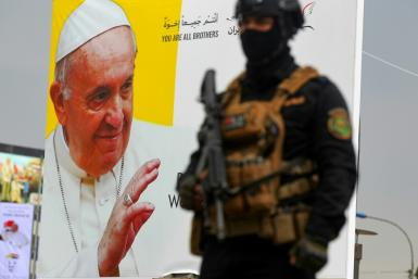 An Iraqi special forces member stands guard outside the Syriac Catholic Church of Our Lady of Deliverance in Baghdad