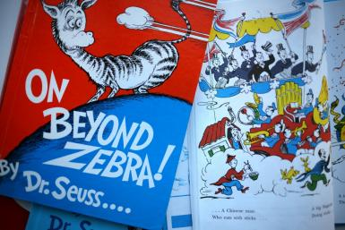 Bids for Dr Seuss books such as 'On Beyond Zebra!' had soared on eBay after their publisher announced it would pull six titles over imagery considered racist