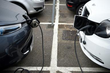 Electric vehicles charge at a charging station in east London