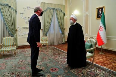 Iran's President Hassan Rouhani (R) receives Irish Foreign Minister Simon Coveney in the capital Tehran on Sunday