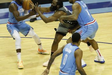 James Harden #13 of the Brooklyn Nets loses the ball as he is pressured by P.J. Tucker #17 of the Houston Rockets and Victor Oladipo #7
