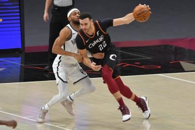 Larry Nance Jr. #22 of the Cleveland Cavaliers drives around Bruce Brown #1 of the Brooklyn Nets