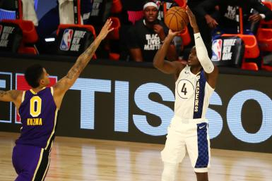 Victor Oladipo #4 of the Indiana Pacers shoots the ball against Kyle Kuzma #0 of the Los Angeles Lakers
