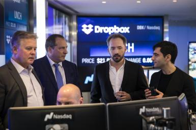 Dropbox CEO Drew Houston (2nd from R) and Dropbox co-founder Arash Ferdowsi are seen at Dropbox's initial public offering at Nasdaq MarketSite, March 23, 2018