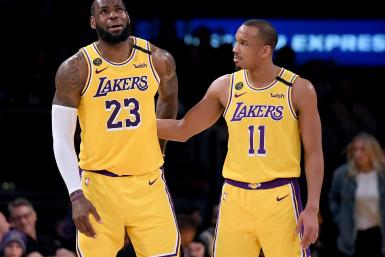 LeBron James #23 of the Los Angeles Lakers reacts to Avery Bradley #11