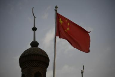 The two Uyghur former government officials were found guilty of carrying out 'separatist activities' in China's Xinjiang