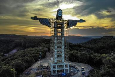 A head and arms have been added to the Christ the Protector statue being built in the southern Brazilian city of Encantado; it stands taller than Rio's iconic statue of Christ the Redeemer
