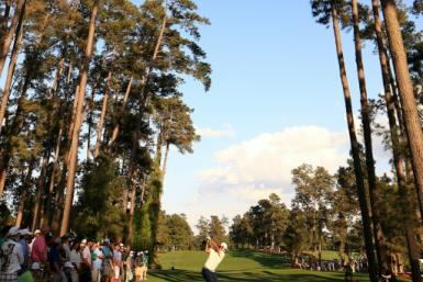 Hideki Matsuyama tees off on the 17th hole at Augusta National as he closes in on victory in the Masters