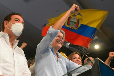 Former banker Guillermo Lasso (R) won Ecuador's presidential election after a campaign dominated by an economic crisis aggravated by the Covid-19 pandemic