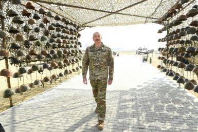 Azerbaijani President Ilham Aliyev tours the Military Trophy Park showcasing military equipment seized from Armenian troops