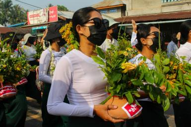Protestors have been painting pro-democracy messages on clay flower pots traditionally displayed to welcome the Myanmar new year during the Thingyan festival
