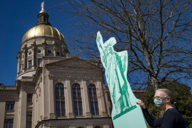 Demonstrators protest outside of the Georgia capitol building in opposition to legislation tightening voting restrictions on March 8, 2021 in Atlanta