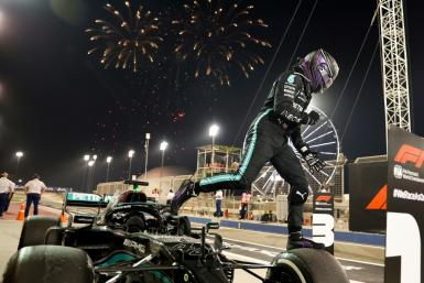 Winning start: Lewis Hamilton celebrates after victory in the season-opening Bahrain Grand Prix