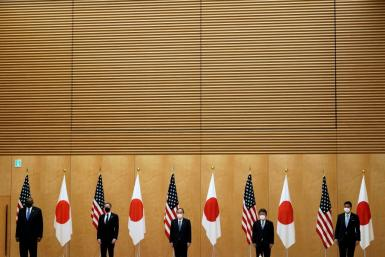 US Secretary of State Antony Blinken and Defense Secretary Lloyd Austin pose with Japan's Prime Minister Yoshihide Suga, Foreign Minister Toshimitsu Motegi and Defense Minister Nobuo Kishi in March 2021 as the new US administration focuses on allies