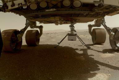 NASA's Ingenuity Mars Helicopter, with all four of its legs deployed, is pictured before dropping from the belly of the Perseverance rover in March 2021