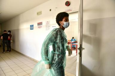 Poll workers wore protective personal equipment as Cape Verde battles a surge in coronavirus cases