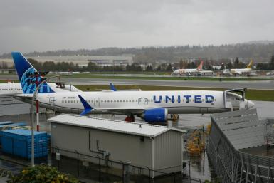 United Airlines reported another quarterly loss but said it sees a path to profitability as travel demand recovers