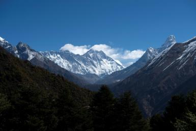 Mount Everest (centre L) has been plagued by overcrowding in recent climbing seasons
