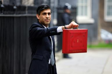 "British finance minister Rishi Sunak showing the Budget Box last month. The statistics office says the pandemic had a ""substantial impact"" on the economy and public debt."
