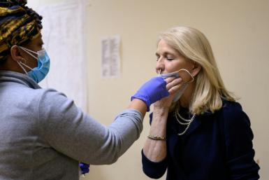 Actress Catherine Russell receives a Covid-19 test prior to performing in New York's longest-running play 'Perfect Crime'