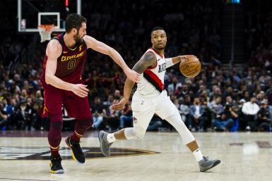 Kevin Love #0 of the Cleveland Cavaliers guards Damian Lillard #0 of the Portland Trail Blazers