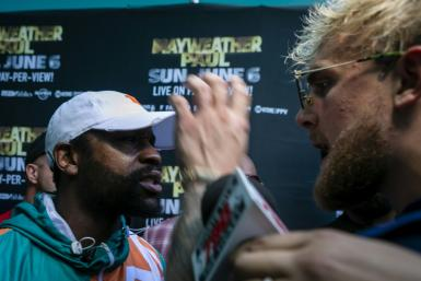 Tempers flare as Floyd Mayweather and Jake Paul confront each other during a media event for Mayweather's June 6 fight with Logan Paul in Miami on Thursday