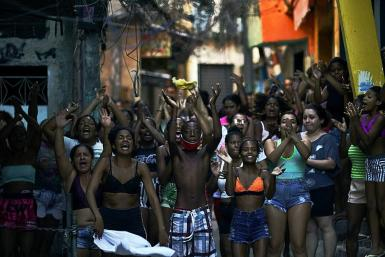 Residents protest after a police operation against alleged drug traffickers at the Jacarezinho favela in Rio de Janeiro state