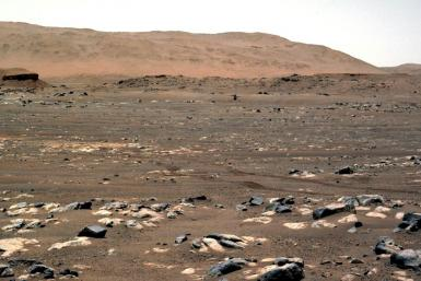 This NASA photo shows NASA's Ingenuity Mars Helicopter achieves powered, controlled flight for the first time on another planet