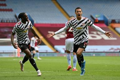 Manchester United forward Mason Greenwood (R) celebrates scoring at Aston Villa