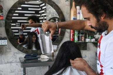 Abbas's fringe style is proving a hit in the conservative nation, with customers flocking to his shop in the eastern city of Lahore