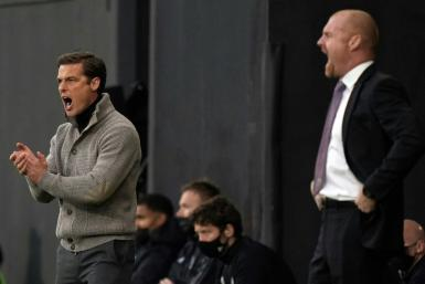 Going down, staying up - Rival managers Scott Parker (Fulham, L) and and Sean Dyche (Burnley R) urge their sides on during a x-x win for Burnley that saw Fulham relegated from the Premier League