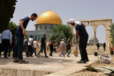 Palestinians clean Jerusalem's Al-Aqsa mosque compoundfollowing renewed clashes between Palestinians and Israeli police
