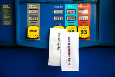 Notes are left on pumps to let motorists know they are empty at an Exxon gas station in Charlotte, North Carolina