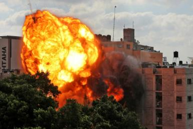 Fire engulfs a building after an Israeli airstrike on Gaza City Thursday