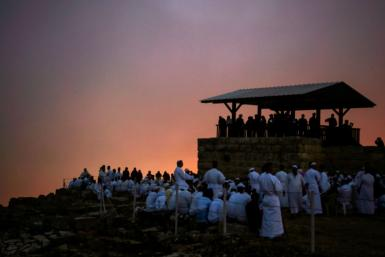 Samaritan worshipers gather at dawn on top of Mount Gerizim near the northern West Bank city of Nablus during celebrations of Shavuot