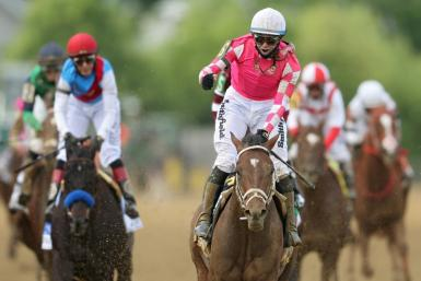 Jockey Flavien Prat celebrates after piloting Rombauer to victory in the Preakness Stakes