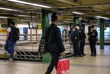 Police officers patrol New York's Union Square subway station on May 10, 2021