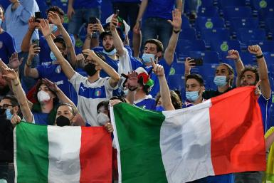 Italy supporters celebrate after their team beat Turkey 3-0 in Rome in the opening game of Euro 2020 on Friday