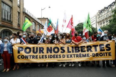 """More than 100 left-leaning organisations participated in the """"Liberty March"""" in cities and towns across France"""