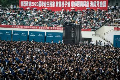 Almost 9,000 students, many of whom could not attend a graduation ceremony last year, gathered in Wuhan sans face masks and social distancing