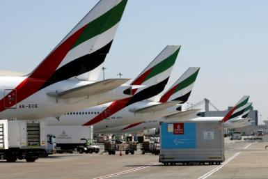 An Emirates Airlines Boing 777 plane unloads a coronavirus vaccine shipment at Dubai International Airport in this picture taken on February 1, 2021