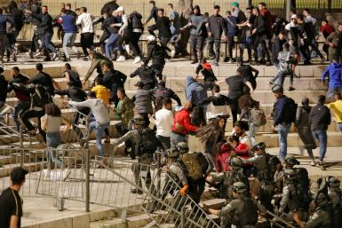 Israeli security forces disperse Palestinians protesting a march by far-right Jews into annexed east Jerusalem on April 22
