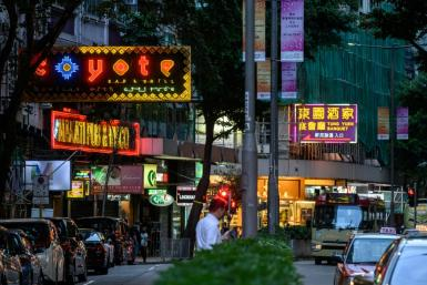 Hong Kong's entertainment district Wanchai has been battered by a coronavirus driven collapse in tourism and as times get desperate, several men have seen their night out turn into a nightmare