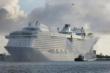 Royal Caribbean pushed back an inaugural voyage on a new ship after eight crew members tested positive for Covid-19