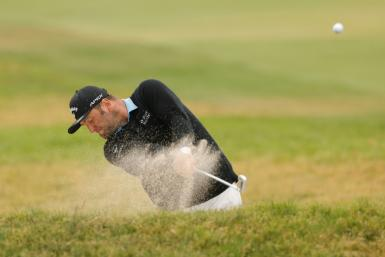 Spain's Jon Rahm blasts out of a bunker during Friday's second round of the US Open at Torrey Pines, where the world number three grinded out a one-under par 70