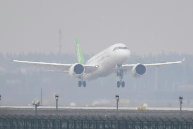China's home-grown C919 passenger jet taking off from Shanghai's Pudong International Airport on its maiden flight in 2017